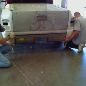 at the body shop gettin roll pan fitted on (at the same time new step side bed being put on)