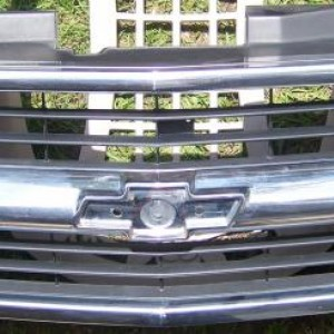 Stock grille before black chrome finish.