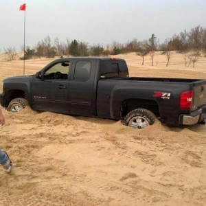 Stuck after trying to tow another truck up a dune at Silver Lake.