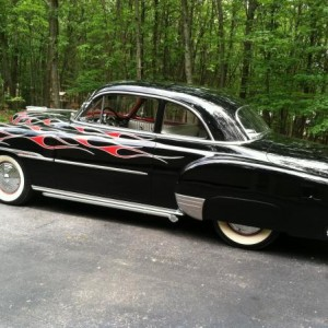"My 51 Chevy ""Josephene"". Shaved, nosed, decked, flamed, and striped. Rear fenders extended 3in with Merc Taillights. 235ci 6cyl, 2 speed Powerglide, O"