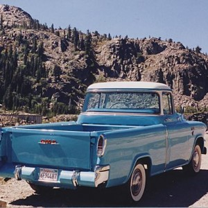 55 GMC at Donner Pass in Sierra Nevada mountains. Rear view shows fiberglass body with car-like taillights.