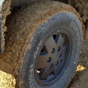 Muddy Firestone tire